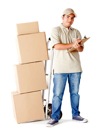 Delivery man holding a clipboard to sign and a trolley - isolated over a white background photo