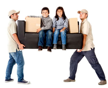 man couch: Delivery men carrying a heavy couch with kids - isolated over a white background Stock Photo