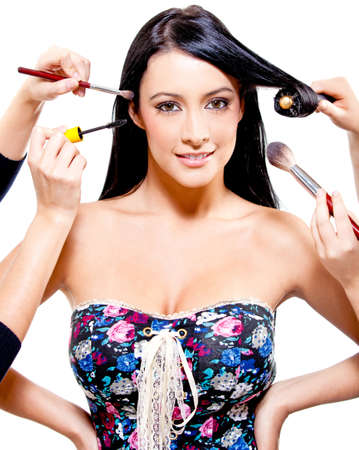 Woman getting professional hair and makeup styling - beauty concepts photo