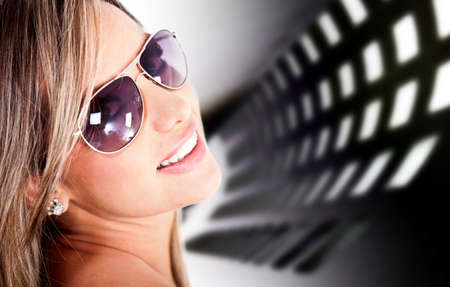 Portrait of a beautiful woman wearing sunglasses  Stock Photo - 12197942