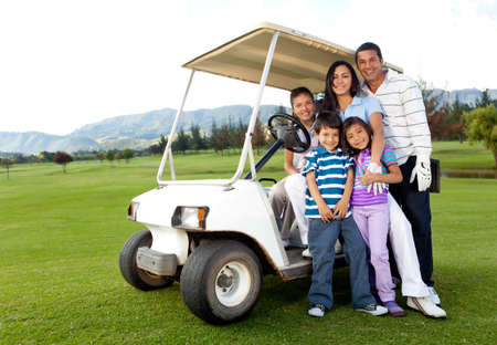 Beautiful family portrait with a cart at the golf course photo