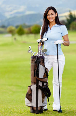 playing golf: Woman playing golf with a bag at the course