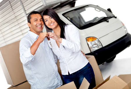 Couple moving and holding the keys of their new home Stock Photo - 12197857