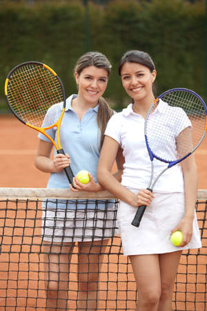 Beautiful women playing tennis and looking happy  photo