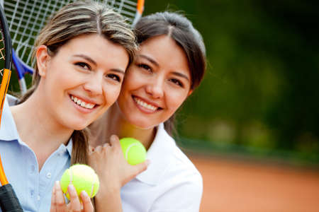 Beautiful women at the tennis court ready to play  photo