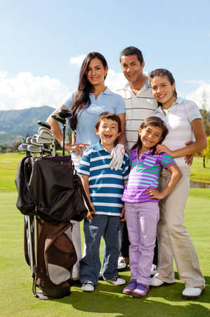 Beautiful family at the golf field looking happy photo