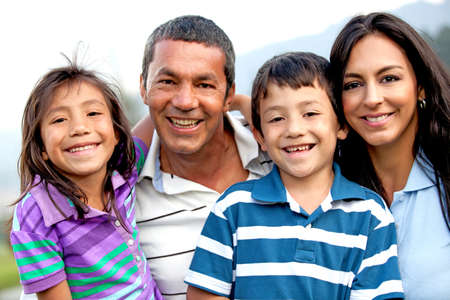 hispanic: Beautiful family portrait looking happy and smiling outdoors