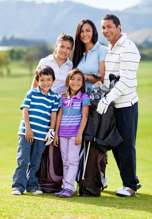 Family of golf players at the course looking happy  photo