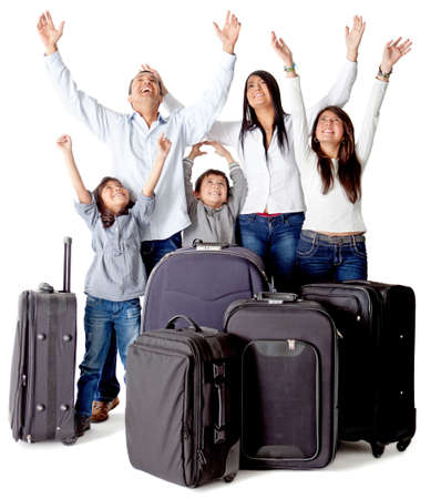 Family with luggage excited about a trip - isolated over a white background photo
