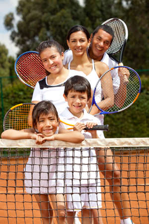 tennis clay: Five member family at the tennis court