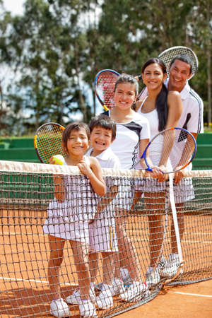 Multi-aged group of tennis players at the court  photo