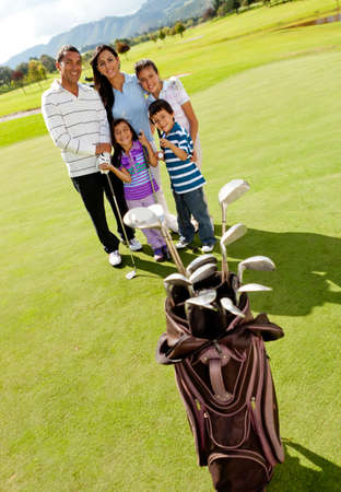 Family at the golf field looking happy photo