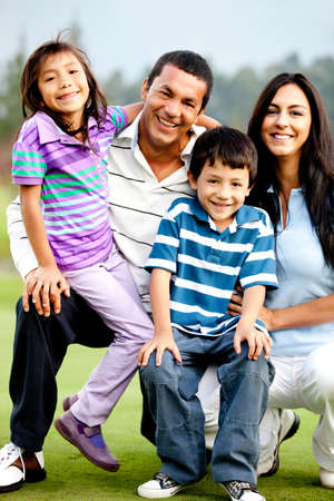 hispanic children: Beautiful family portrait outdoors looking happy and smiling