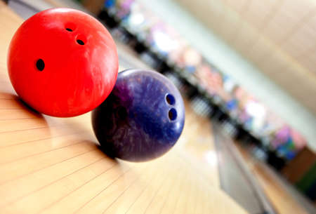Close-up of balls in an bowling alley photo