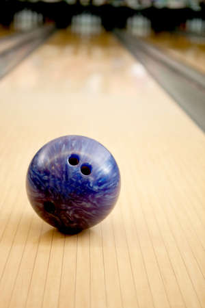 Close-up of a purple bowling ball in an alley photo