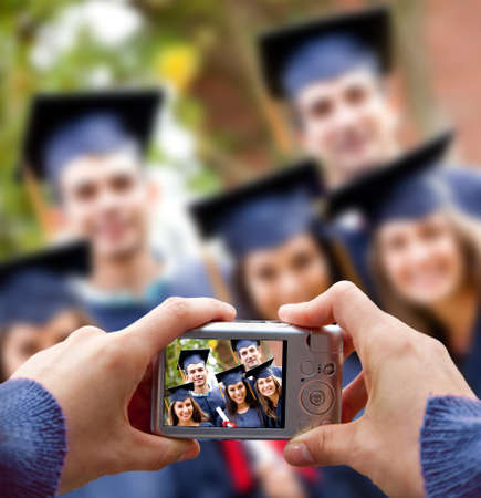 taking photograph: Group of students taking a picture in their graduation