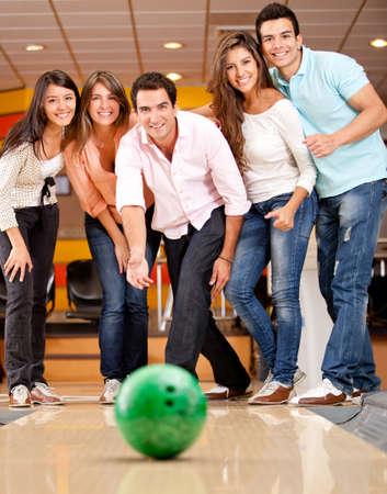 friends having fun: Happy group of friends having fun bowling
