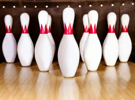 red pin: Pins at the end of a bowling alley  Stock Photo