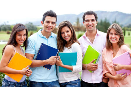 Happy group of students outdoors holding notebooks  photo