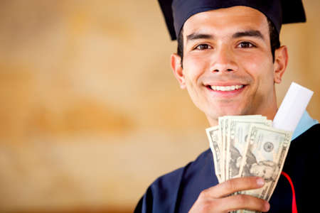 scholarship: Male graduated holding money - Education costs concepts  Stock Photo