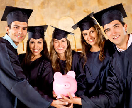 Graduate students holding a piggybank with education savings  Stock Photo - 12393591