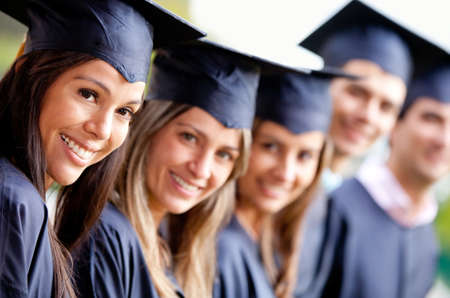 graduation ceremony: Graduation group with students in a row  Stock Photo