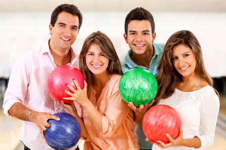 bowling: Group of people having fun bowling and smiling