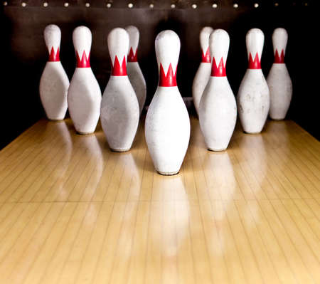 bowling: Ten white pins in a bowling alley