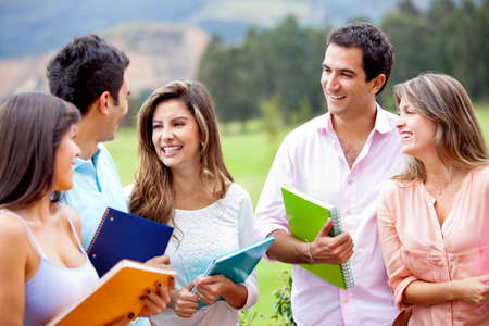 adults learning: Happy group of students talking outdoors smiling  Stock Photo