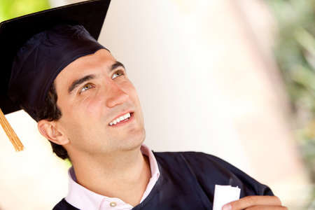 Portrait of a pensive man graduating wearing a mortarboard  photo
