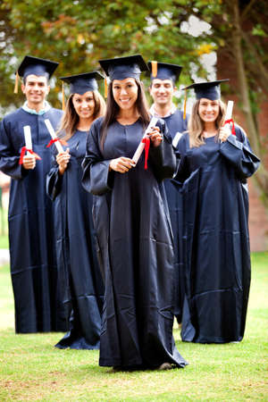academic robe: Happy group of students in their graduation smiling Stock Photo