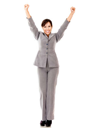 Business woman with arms up celebrating her success - isolated over white  Stock Photo - 12393619