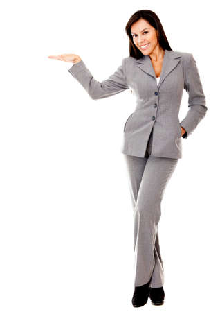 Business woman with hand extended on an imaginary object - isolated  Stock Photo - 12393649