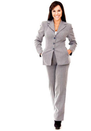 Business woman walking - isolated over a white background Stock Photo - 12393616
