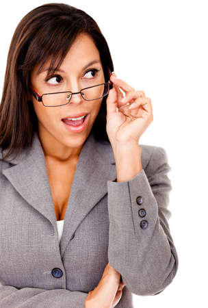 Surprised business woman looking to the side and holding glasses - isolated  photo