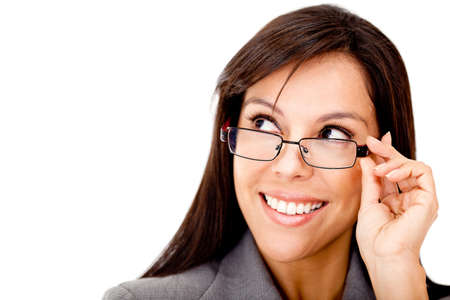 Clever business woman with glasses looking to the side - isolated over a white background photo