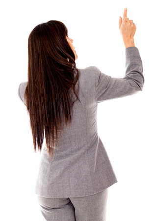 back straight: Rear view of a business woman pointing - isolated over white  Stock Photo