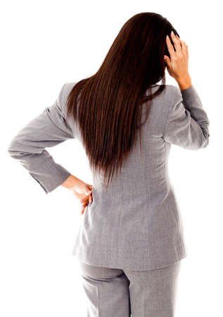 Business woman having problems scratching her head - isolated over white  photo