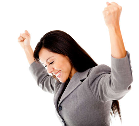 Successful businesswoman with arms up - isolated over a white background photo
