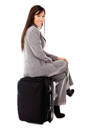 Business woman traveling with her bag - isolated over a white background Stock Photo - 12393667