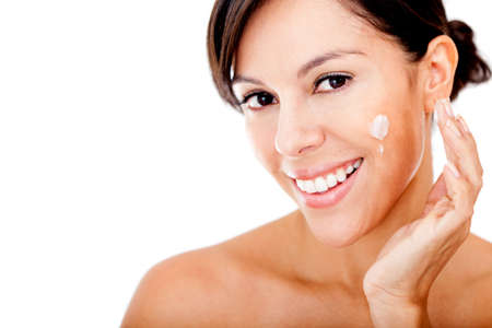 woman face cream: Skincare portrait of a woman putting cream in her face - isolated