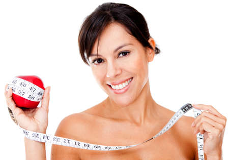 Healthy eating woman holding an apple and a tape measure - isolated  photo