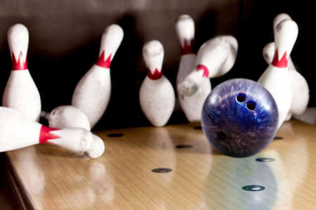 Bowling strike - ball hitting pins in the alley    photo