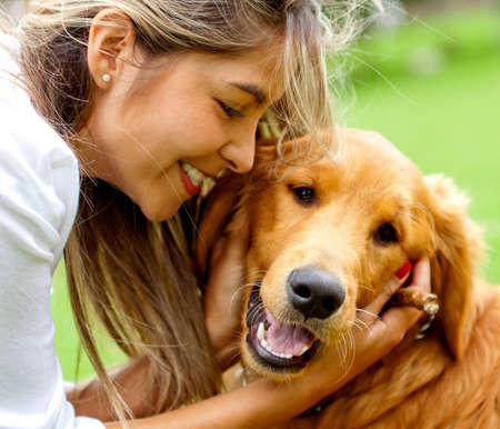 pretty young girl: Cute portrait of a woman with her dog at the park