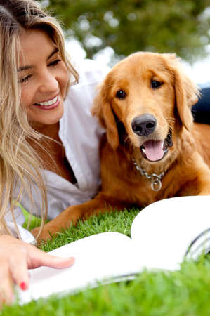 Beautiful woman enjoying with her dog outdoors Stock Photo - 12393603