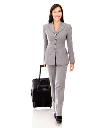 Woman going on a business trip carrying her bag - isolated over a white background  photo