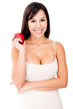 Woman on a diet holding a red apple - isolated over a white background Stock Photo - 12393692