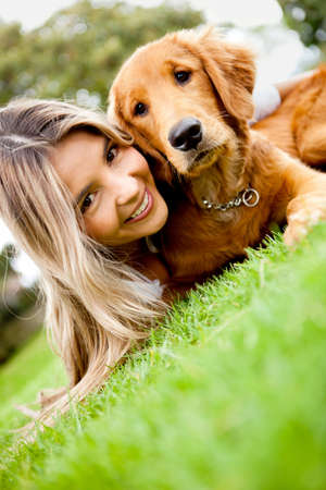 Girl with a cute puppy dog outdoors photo