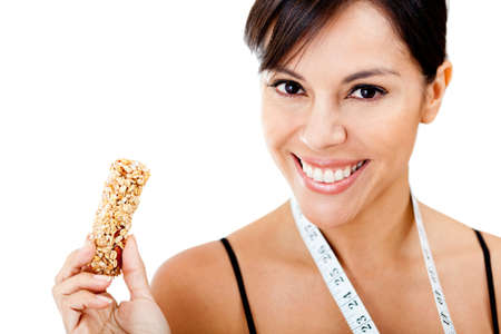 white bars: Healthy eating woman holding granola bar - isolated over a white background