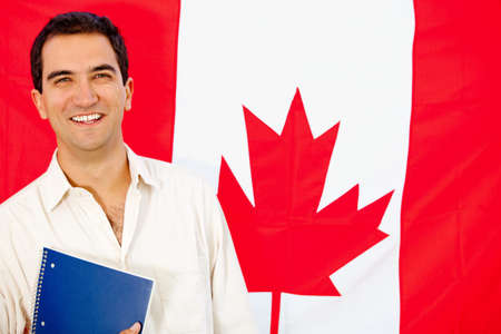 Man studying English or French in Canada with the flag at the mackground photo